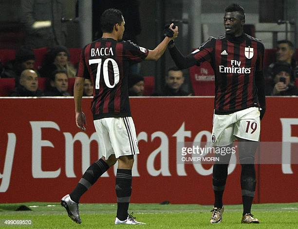 AC Milan's French forward Mbaye Niang celebrates with a teammate after scoring a penalty kick during the Italian Serie A football match AC Milan vs...