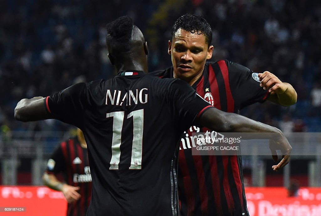 AC Milan's French forward Mbaye Niang celebrates with AC Milan's Colombian forward Carlos Bacca (R) after scoring a goal during the Italian Serie A football match between AC Milan and SS Lazio at the San Siro Stadium in Milan, on September 20, 2016. / AFP / GIUSEPPE