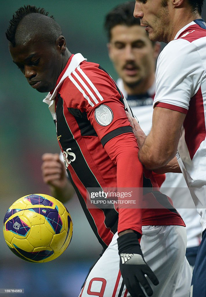 AC Milan's French forward M'Baye Niang (L) vies with FC Bologna's defender AC Milan's French forward M'Baye Niang (L) and FC Bologna Nicolo Cherubini during their Serie A football match in Milan's San Siro Stadium on January 19, 2013.