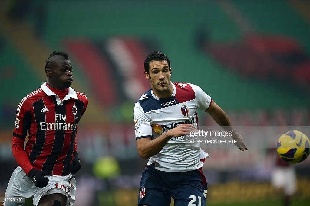 AC Milan's French forward M'Baye Niang vies with FC Bologna's defender Nicolo Cherubin during their Serie A football match in Milan's San Siro Stadium on January 19, 2013.