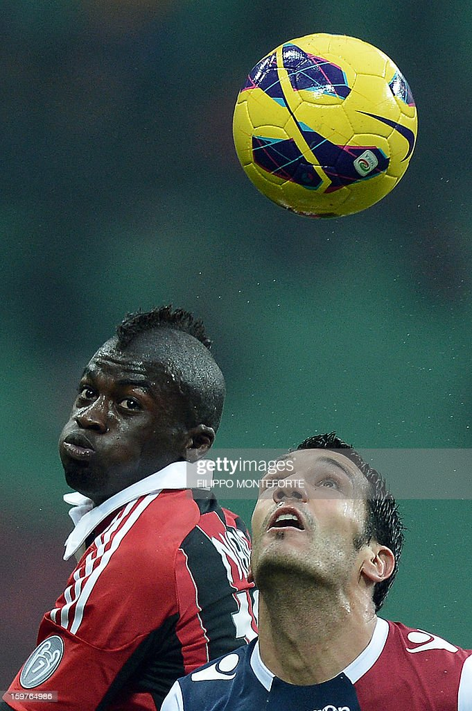 AC Milan's French forward M'Baye Niang (L) vies with FC Bologna's defender Nicolo Cherubini during their Serie A football match in Milan's San Siro Stadium on January 19, 2013. AFP PHOTO / FILIPPO MONTEFORTE