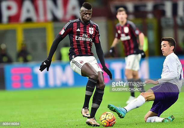 AC Milan's French forward Mbaye Niang vies with Fiorentina's Uruguayan forward Matias Vecino during the Serie A football match between AC Milan and...