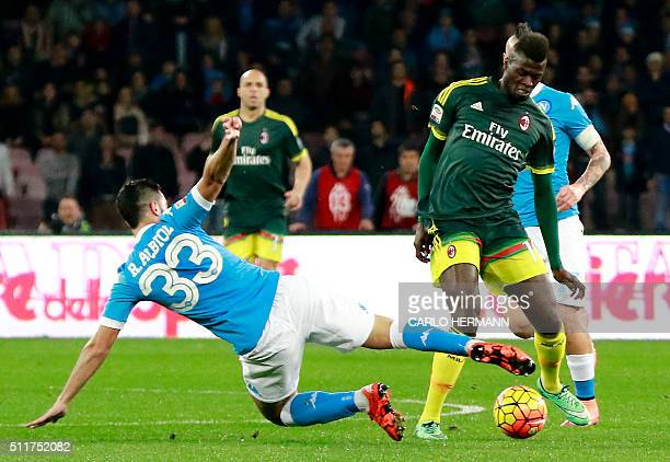 AC Milan's French forward M'Baye Niang vies with Napoli's Spanish defender Raul Albiol during the Italian Serie A football match SSC Napoli vs AC...