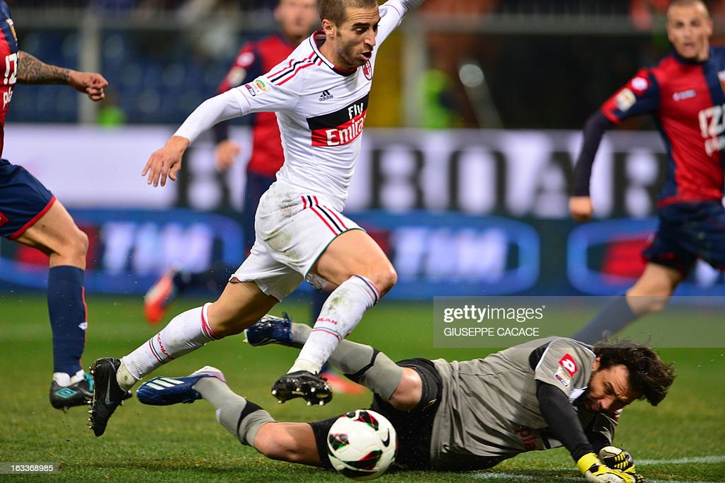AC Milan's French midfielder Mathieu Flamini (L) vies for the ball with Genoa's French goalkeeper Sebastien Frey during the Italian championships Serie A football match Genoa vs AC Milan at the Marazzi Stadium in Genova on March 8, 2013.