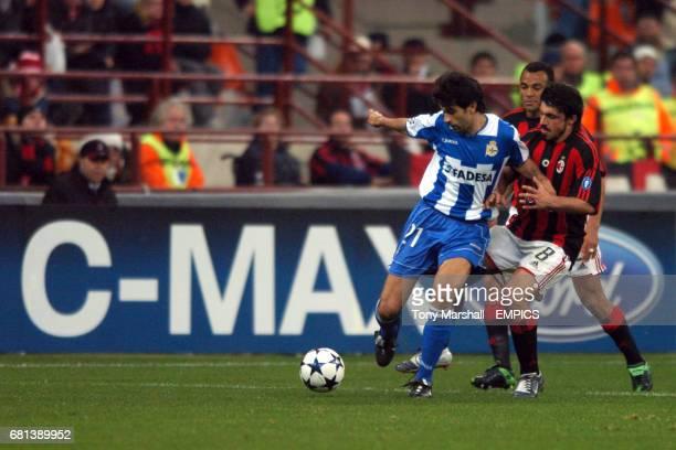 AC Milan's Gennaro Gattuso and Cafu combine to tackle Deportivo La Coruna's Juan Valeron