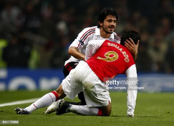 AC Milan's Gennaro Gattuso helps up Arsenal's Da Silva Eduardo following a challenge
