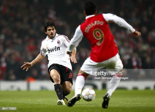 AC Milan's Gennaro Gattuso looks for a way passed Arsenal's Da Silva Eduardo
