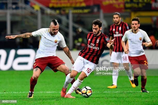 AC Milan's German midfielder Hakan Calhanoglu vies with AS Roma's Belgian midfielder Radja Nainggolan during the Italian Serie A football match AC...