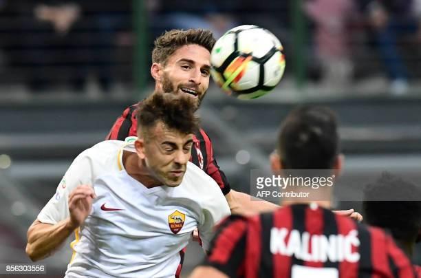 AC Milan's German midfielder Hakan Calhanoglu vies with AS Roma's Italian forward Stephan El Shaarawy during the Italian Serie A football match AC...