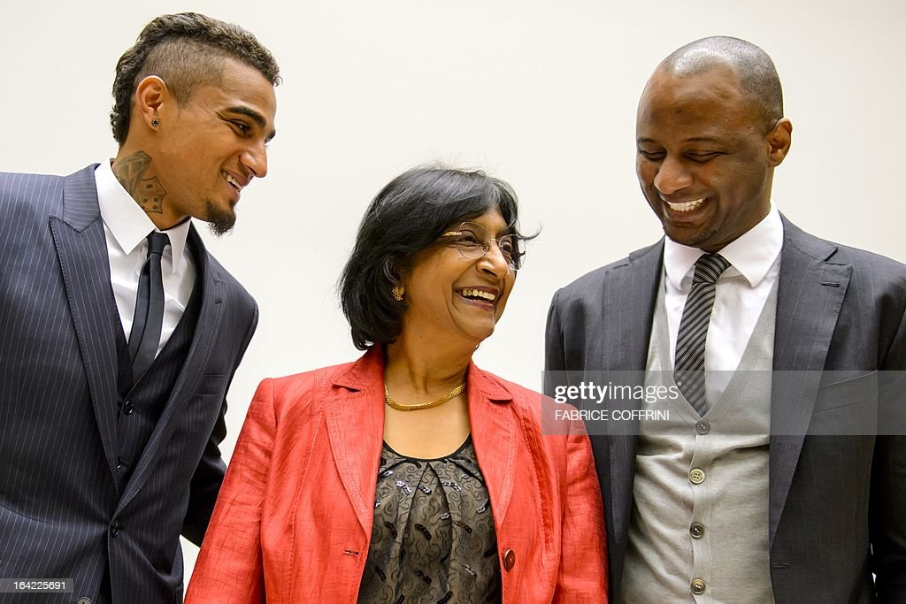 AC Milan's Ghana international Kevin-Prince Boateng (L) and former France captain Patrick Vieira (R) pose with United Nations High Commissioner for Human Rights Navi Pillay (C) prior to the opening of a the panel discussion on racism and sport on March 21, 2013 at the United Nations Office in Geneva, Boateng, lauded by anti-racism campaigners since he walked off a football pitch during a club game in Italy to protest abuse by fans, joined former France captain Patrick Vieira and officials from FIFA, UEFA and the United Nations to discuss how to rid sport of the problem. AFP PHOTO / FABRICE COFFRINI