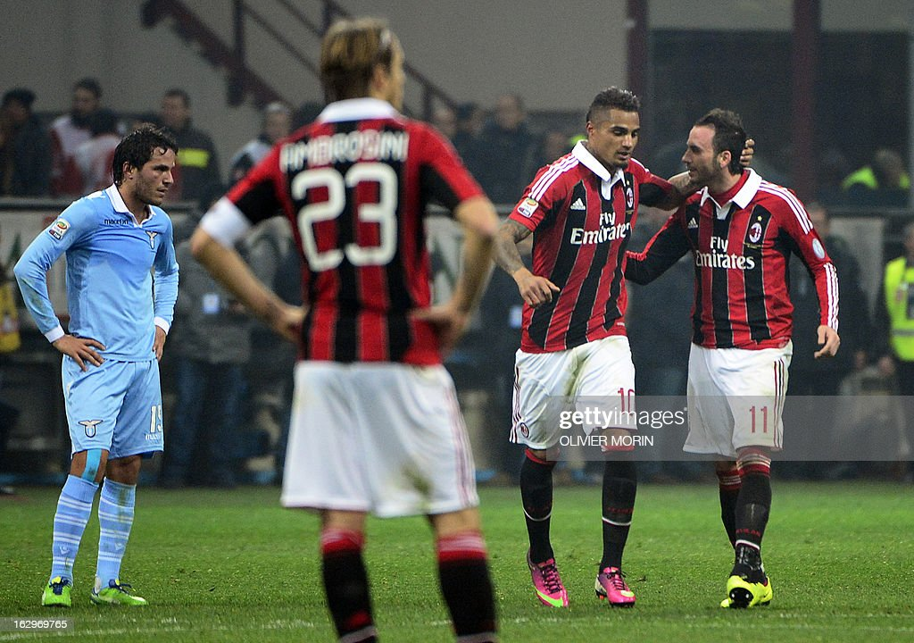 AC Milan's Ghanaian defender Prince Kevin Boateng (2nd R) celebrates with AC Milan's forward Giampaolo Pazzini (R) after scoring during the Italian Serie A football match between AC Milan and Lazio, on March 2, 2013 at the San Siro stadium in Milan.