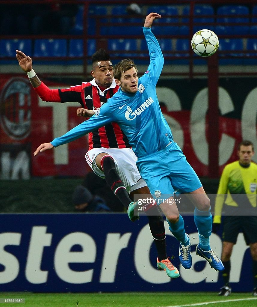 AC Milan's Ghanaian defender Prince Kevin Boateng (L) fights for the ball with FC Zenit's Belgian defender Nicolas Lombaerts during the Champions league match between AC Milan and Zenith St Petersburg on December 4, 2012 at the San Siro stadium in Milan. AFP PHOTO / OLIVIER MORIN