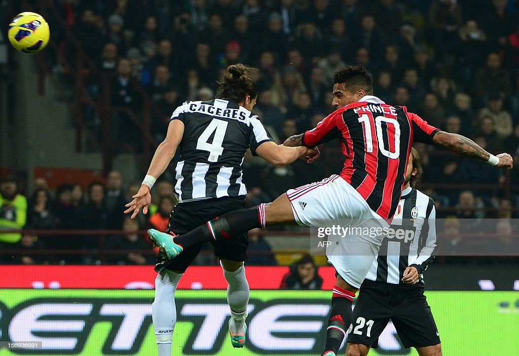 AC Milan's Ghanaian defender Prince Kevin Boateng (R) fights for the ball with Juventus' Uruguaian defender Martin Caceres during the Italian serie A football match between AC Milan and Juventus on November 25, 2012 at the San Siro stadium in Milan. AFP PHOTO / OLIVIER MORIN