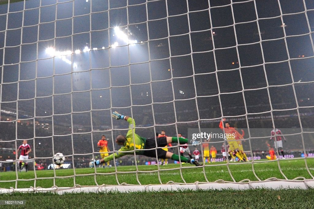 AC Milan's Ghanaian defender Prince Kevin Boateng kicks and score during the Champions League football match between AC Milan and FC Barcelona on February 20, 2013 at San Siro Stadium in Milan.