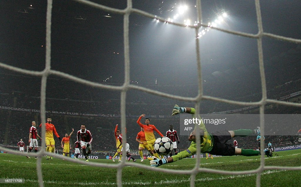AC Milan's Ghanaian defender Prince Kevin Boateng (C) scores during the Champions League football match between AC Milan and FC Barcelona on February 20, 2013 at San Siro Stadium in Milan.