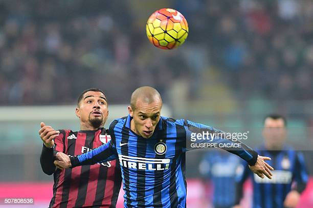 AC Milan's Ghanaian forward KevinPrince Boateng vies for the ball with Inter Milan's Brazilian defender Joao Miranda during the Serie A football...