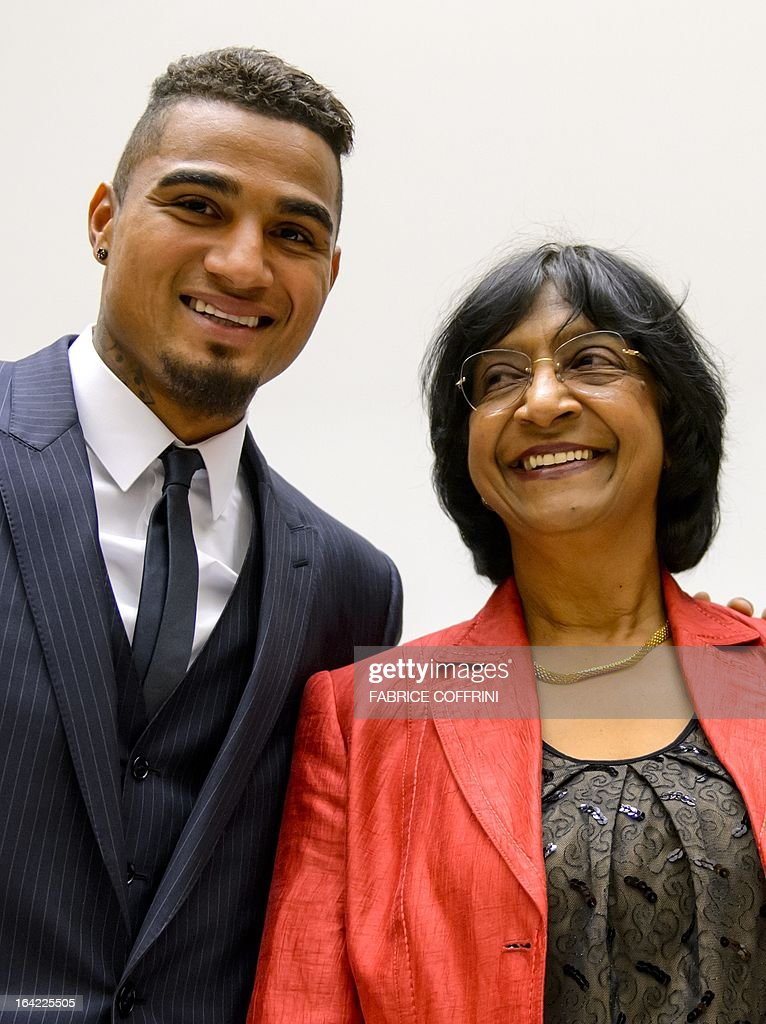 AC Milan's Ghanaian international Kevin-Prince Boateng (L) poses with United Nations High Commissioner for Human Rights Navi Pillay on March 21, 2013 before the opening of a panel discussion on racism and sport at the UN office in Geneva. Boateng, lauded by anti-racism campaigners since he walked off a football pitch during a club game in Italy to protest abuse by fans, joined former France captain Patrick Vieira and officials from the FIFA, UEFA and the United Nations to discuss how to rid sport of the problem.