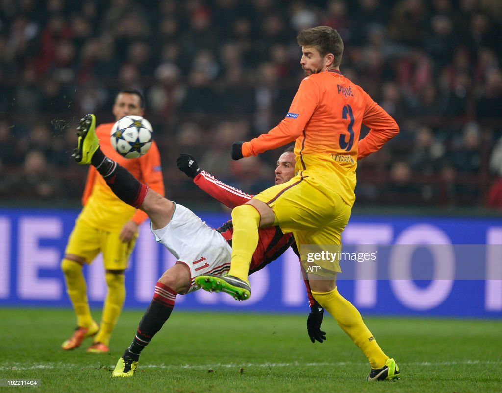 AC Milan's Giampaolo Pazzini (C) fights for the ball with FC Barcelona's Gerard Picque during the Champions League football match between AC Milan and FC Barcelona on February 20, 2013 at San Siro Stadium in Milan.