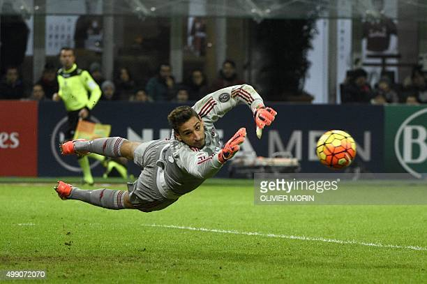 AC Milan's goalkeeper from Italy Gianluigi Donnarumma makes a save during the Italian Serie A football match AC Milan vs Sampdoria on November 28...