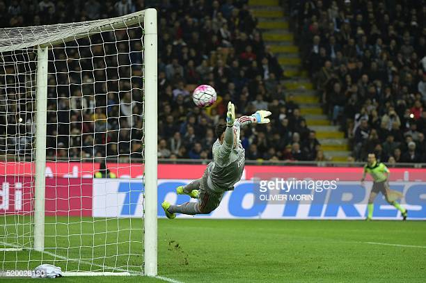 AC Milan's goalkeeper from Italy Gianluigi Donnarumma makes a save during the Italian Serie A football match AC Milan vs Juventus on April 9 2016 at...