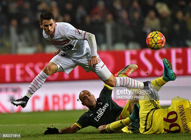 AC Milan's goalkeeper from Italy Gianluigi Donnarumma makes a save in front of Carpi's forward from Italy Kevin Lasagna and AC Milan's defender from...