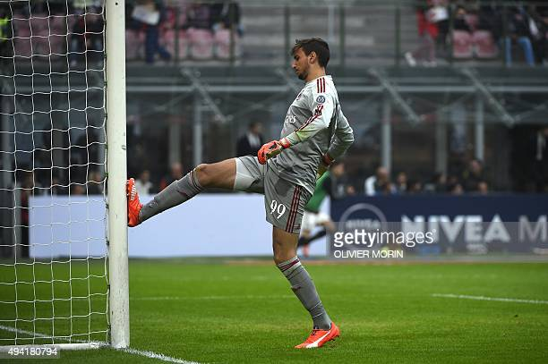 AC Milan's goalkeeper from Italy Gianluigi Donnarumma reacts after a goal during the Italian Serie A football match AC Milan vs Sassuolo on October...