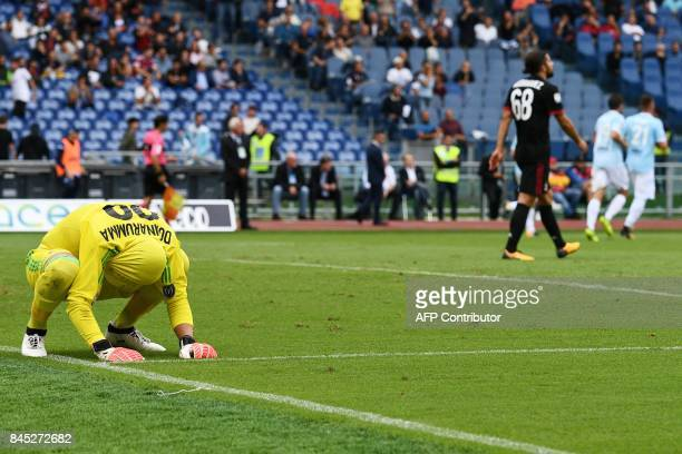 AC Milan's goalkeeper from Italy Gianluigi Donnarumma reacts after Lazio's forward from Italy Ciro Immobile scored a penalty during the Italian Serie...