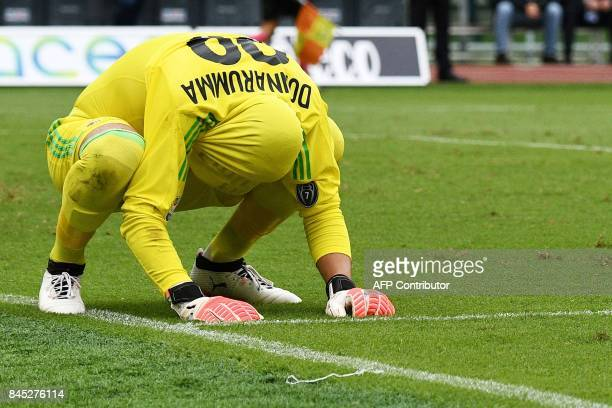 Milan's goalkeeper from Italy Gianluigi Donnarumma reacts after Lazio's forward from Italy Ciro Immobile scored a penalty during the Italian Serie A...