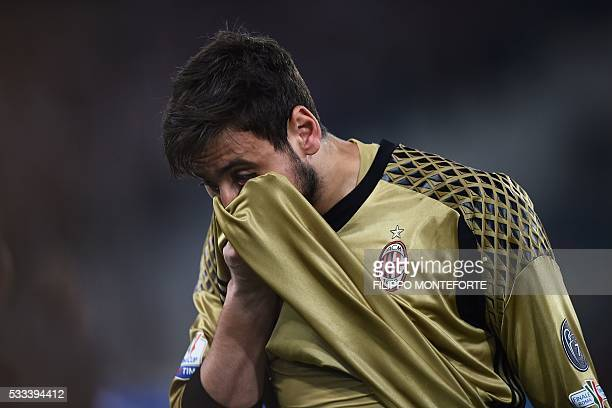 AC Milan's goalkeeper from Italy Gianluigi Donnarumma reacts at the end of the Italian Tim Cup final football match AC Milan vs Juventus on May 21...