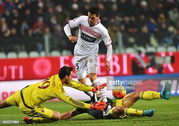 AC Milan's goalkeeper from Italy Gianluigi Donnarumma saves a shot by Carpi's forward from Italy Kevin Lasagna and AC Milan's defender from Brazil...