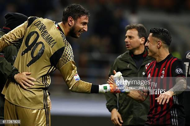 AC Milan's goalkeeper Gianluigi Donnarumma celebrates with AC Milan's forward Giacomo Lapadula after the Italian Serie A football match AC Milan...