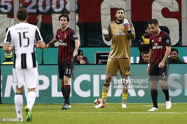 AC Milan's goalkeeper Gianluigi Donnarumma gestures during the Italian Serie A football match AC Milan versus Juventus on October 22 2016 at the San...