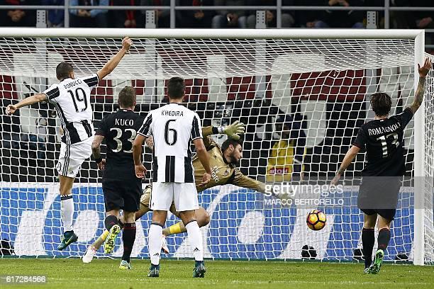 AC Milan's goalkeeper Gianluigi Donnarumma reaches for the ball during the Italian Serie A football match AC Milan versus Juventus on October 22 2016...