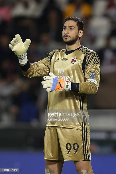 AC Milan's goalkeeper Gianluigi Donnarumma reacts during the Italian Super Cup final match between AC Milan and Juventus in Doha on December 23 2016...