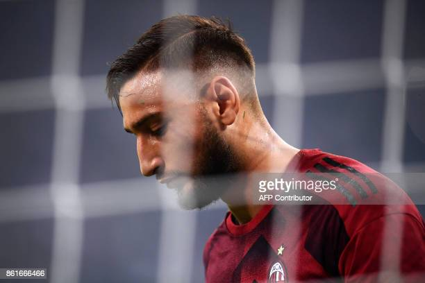 AC Milan's goalkeeper Gianluigi Donnarumma warms up before the Italian Serie A football match Inter Milan Vs AC Milan on October 15 2017 at the 'San...