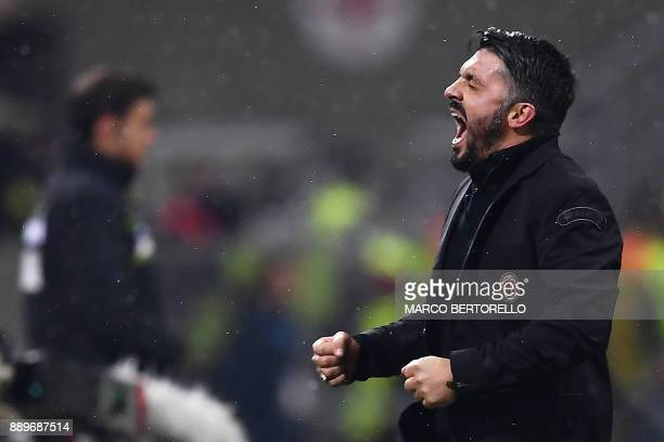 AC Milan's head coach Gennaro Gattuso celebrates at the end of the Italian Serie A football match AC Milan Vs Bologna on December 10 2017 at the 'San...
