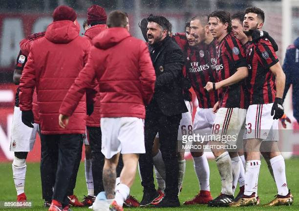 AC Milan's head coach Gennaro Gattuso celebrates with his players at the end of the Italian Serie A football match AC Milan Vs Bologna on December 10...