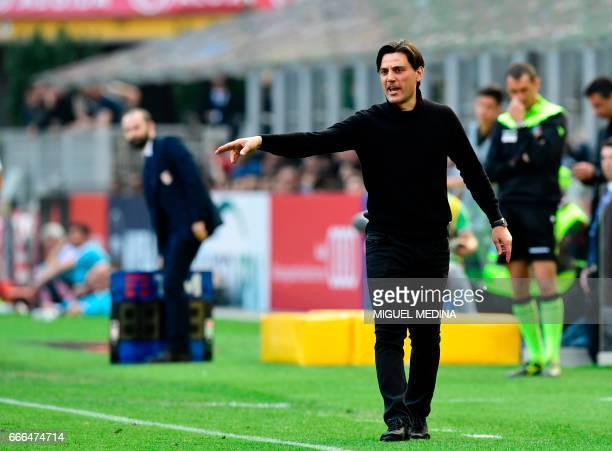 AC Milan's Italian coach Vincenzo Montella gestures during the Italian Serie A football match AC Milan vs Palermo at the San Siro stadium in Milan on...