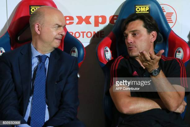 Milan's Italian coach Vincenzo Montella speaks with Milan's manager Marco Fassone during the Italian Serie A football match FC Crotone vs AC Milan on...