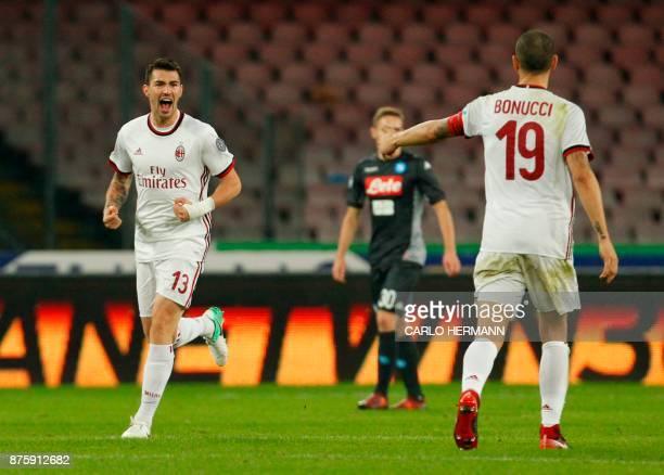Milan's Italian defender Alessio Romagnoli celebrates after scoring during the Italian Serie A football match SSC Napoli vs AC Milan on November 18...
