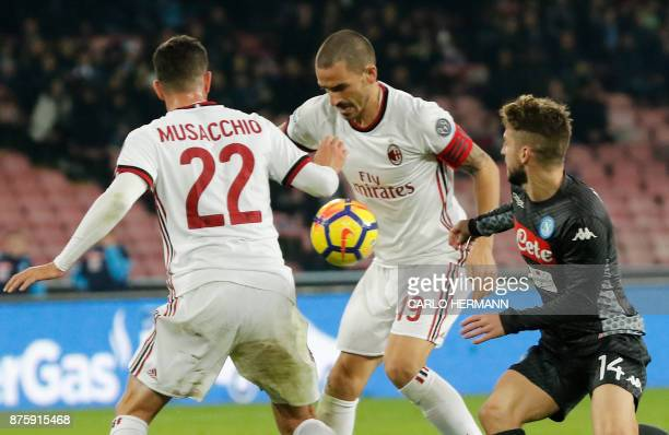 Milan's Italian defender Leonardo Bonucci controls the ball as fighting with Napoli's Belgian striker Dries Mertens during the Italian Serie A...
