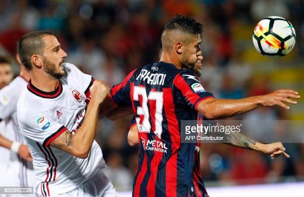 Milan's Italian defender Leonardo Bonucci vies for the ball with Crotone's Italian defender Davide Faraoni during the Italian Serie A football match...