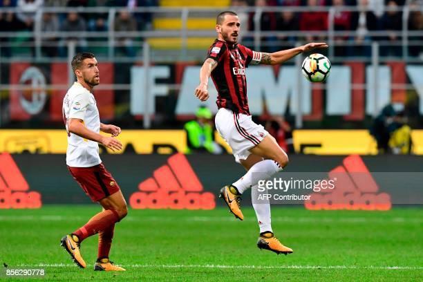 AC Milan's Italian defender Leonardo Bonucci vies with AS Roma's midfielder Kevin Strootman during the Italian Serie A football match AC Milan vs AS...