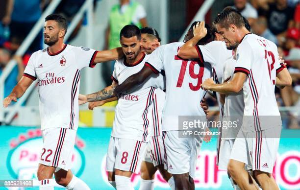 Milan's Italian forward Fernandez Suso celebrates with teammates after scoring a goal during the Italian Serie A football match FC Crotone vs AC...
