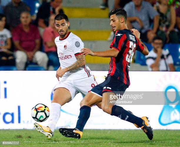 Milan's Italian forward Fernandez Suso vies for the ball with Crotone's Italian midfielder Rolando Mandragora during the Italian Serie A football...