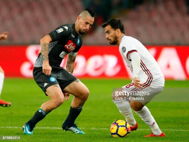Milan's Italian forward Fernandez Suso vies with Napoli's Slovakian midfielder Marek Hamsik during the Italian Serie A football match SSC Napoli vs...