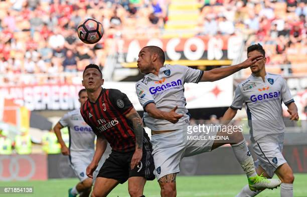 AC Milan's Italian forward Gianluca Lapadula vies with Empoli's Italian defender Giuseppe Bellusci during the Italian Serie A football match AC Milan...