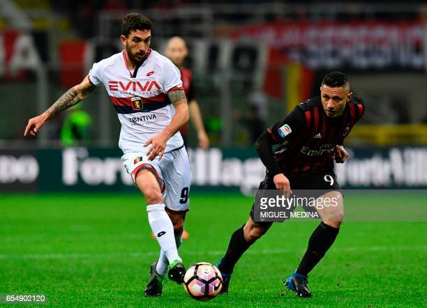 AC Milan's Italian forward Gianluca Lapadula vies with Genoa's Argentinian forward Giovanni Simeone during the Italian Serie A football match AC...
