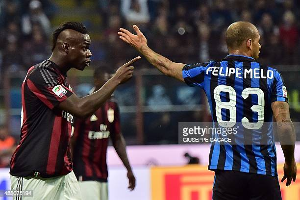 AC Milan's Italian forward Mario Balotelli and Inter Milan's Brazilian midfielder Felipe Melo gesture during the Serie A football match between Inter...