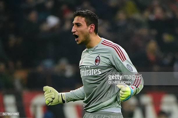 AC Milan's Italian goalkeeper Gianluigi Donnarumma celebrates during the Italian Serie A football match between AC Milan and Inter Milan at San Siro...